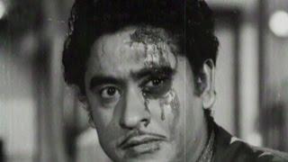Ashok Kumar hits Kishore Kumar with a bottle - Bhai Bhai, Scene 11/15 width=