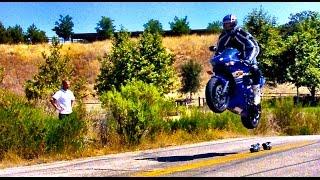 getlinkyoutube.com-GSXR1000 goes off jump and lands doing a wheelie