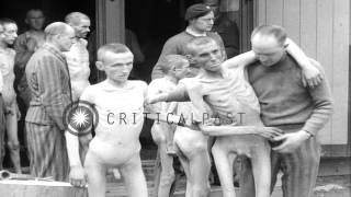 getlinkyoutube.com-Emaciated prisoners of a Nazi concentration camp in Ebensee, Austria released aft...HD Stock Footage