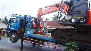 Loading a Hitachi Zaxis 210 excavator onto a trailer in Indonesia