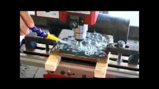 "getlinkyoutube.com-CNC Desktop Mini Mill with Fluid control cutting 3/8"" steel"