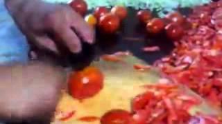 getlinkyoutube.com-اسرع عامل مطعم يقطع الطماطم