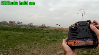 Cheapass quadcopter tries altitude hold