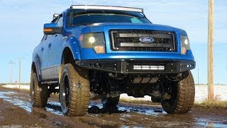 getlinkyoutube.com-Lifted Ford F-150 4x4 hits a Mud Puddle on Icy Dirt Road