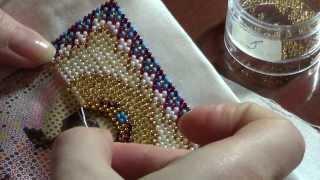 Процесс вышивки иконы бисером
