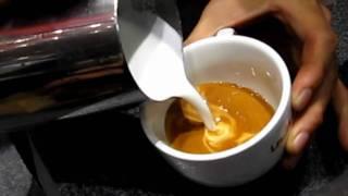 getlinkyoutube.com-SCAJ2010: Mr. Hiroyuki Kadowaki performs latteart with La Marzocco strada EP-3.