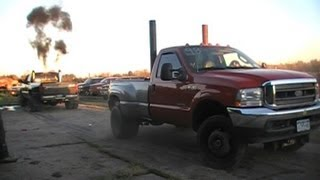 getlinkyoutube.com-Barnyard Boggers TUG OF WAR Diesel Power