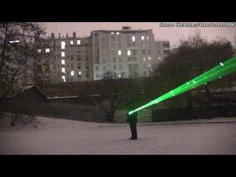 1,000 mw blue laser beams in falling snow + green laser beam * lightsaber?     IMG *
