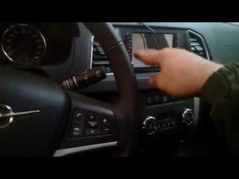 Где находится у UAZ Патриот кнопка бензобака
