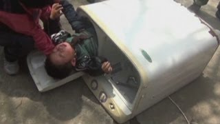 getlinkyoutube.com-Two-year-old boy rescued from washing machine