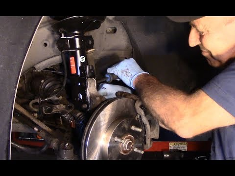 How to replace the front strut assembly on a 2006 Chevy Cobalt