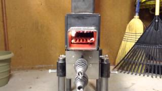 getlinkyoutube.com-Pellet Rocket stove all plumbed up
