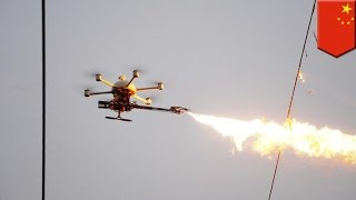 getlinkyoutube.com-Flaming drones: China uses fire-spewing drones to burn trash off power lines - TomoNews