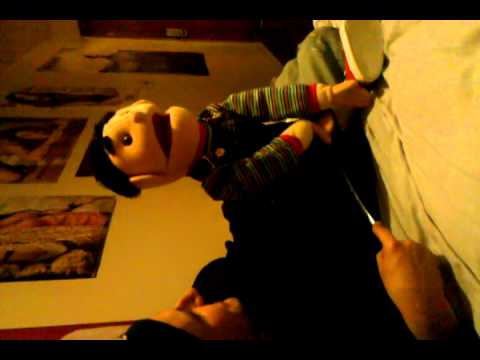 Doug plays with a puppet