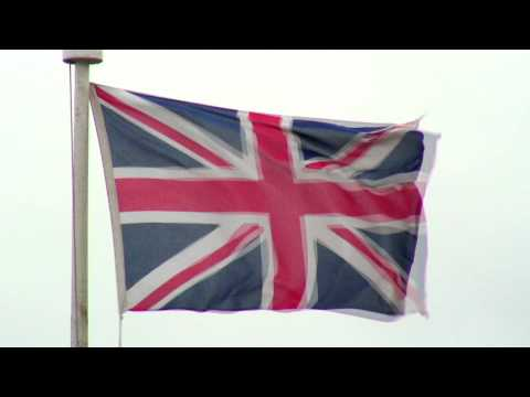 Close-up shot of a United Kingdom flag waving in the wind.