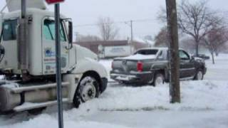 getlinkyoutube.com-1/2 Ton Chevrolet Avalanche truck pulls stuck Semi & trailer out of snow