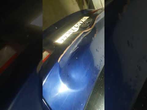 Где кнопка открывания лючка бензобака у Honda Orthia