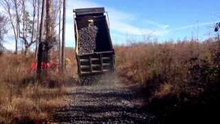 getlinkyoutube.com-Dump truck with straight pipe spreading rock