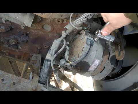 1Часть. Снятие генератора(грузовик) Манипулятор ниссан дизель fe-6. Nissan diesel ud