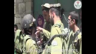 Israeli soldiers arresting and beating children in Hebron