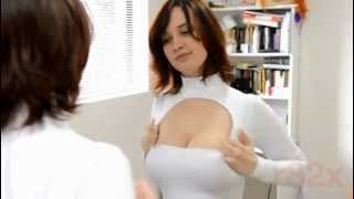 Girl's breast expand while trying out outfit