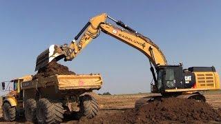 getlinkyoutube.com-Cat 352F Excavator Loading Volvo A30G Dumpers With 1 Meter Wide LGP Tires