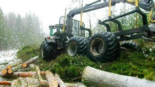 getlinkyoutube.com-Valtra T131h forestry tractor loading pine logs in winter forest