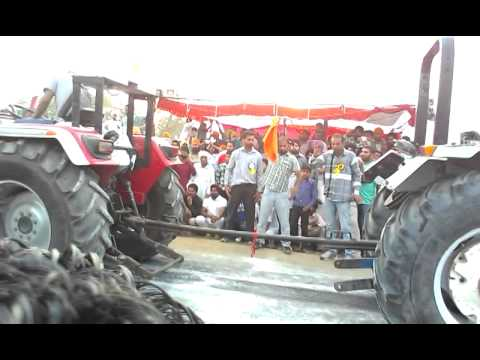 Arjun 605 vs new holland
