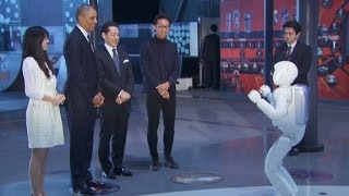 Robot playing soccer with President Obama ....