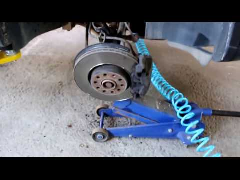 Volkswagen Tiguan Фольксваген Тигуан 2009 год Замена подшипника опоры передней стойки