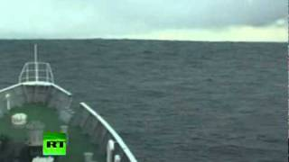 getlinkyoutube.com-Tsunami Climbing: Incredible video of ship heading into wave in Japan