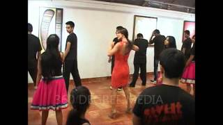 Sexy back Malaika Arora Khan in a tight red dress practicing dance moves - Strut Dance Academy