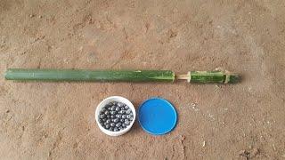 How to Make a Bamboo Gun that shoots Fruit bullets (Kamplok) - Khmer Traditional