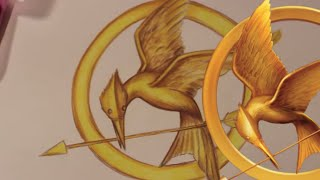 getlinkyoutube.com-How to Draw the MOCKINGJAY Symbol from The Hunger Games - @DramaticParrot