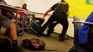 getlinkyoutube.com-HD New Angle Cop Violently Attacks Peaceful Female Student Sitting in Her Desk