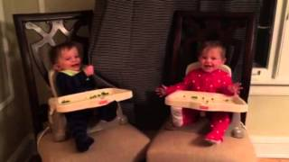 Twins play peekaboo with each other