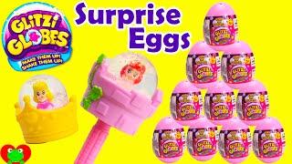 getlinkyoutube.com-Glitzi Globes Surprise Eggs with Disney Princess Ariel and Aurora
