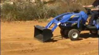 getlinkyoutube.com-New Holland Boomer Spreading and Grading