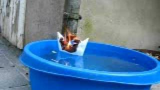 Paper Boat on fire while swimming