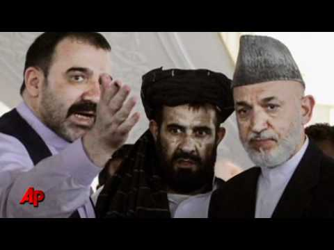 Afghan President Buries Slain Half Brother