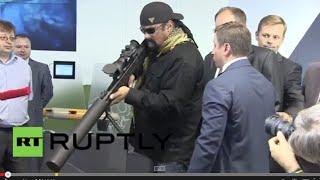 getlinkyoutube.com-Russia: Steven Seagal wields Russian sniper rifles at OboronExpo 2014