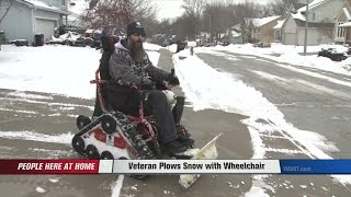 getlinkyoutube.com-Veteran Plows Snow with Wheelchair