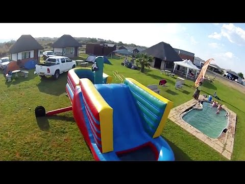Skydiver Lands On Pirate Bouncy Castle!