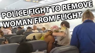 getlinkyoutube.com-Police Fight Disruptive Woman off Spirit Airlines Flight