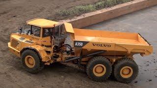 getlinkyoutube.com-RC Cat Dumpers in Action! Nice realistic Dump Trucks at work.