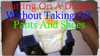 getlinkyoutube.com-How To Put Diaper Without Taking Off Pants And Shoes In Less Than 2 Minutes
