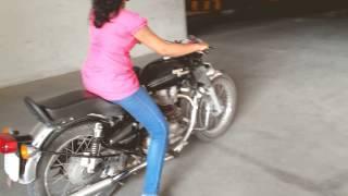 getlinkyoutube.com-Girl hand starting Royal enfield Bullet