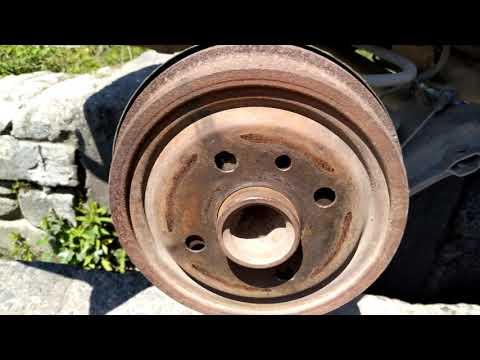 Где трос ручного тормоза у Opel Tigra