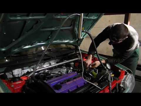 Где в Mazda 323 впускной коллектор