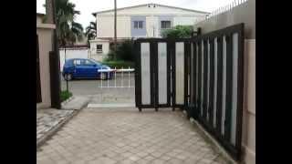 ประตูบานเลื่อนโค้งอัตโนมัติ ประตูรั้วรีโมทแบบโค้งอัตโนมัติ